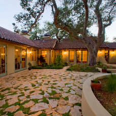 Mediterranean Exterior by McNamee Construction