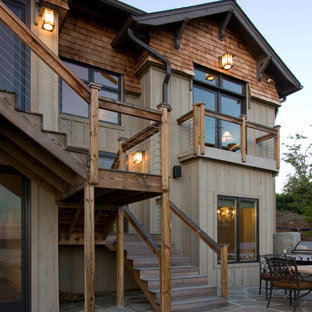 Mid-sized mountain style two-story wood exterior home photo in Other