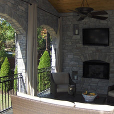 Eclectic Exterior by ARNOLD Masonry and Landscape