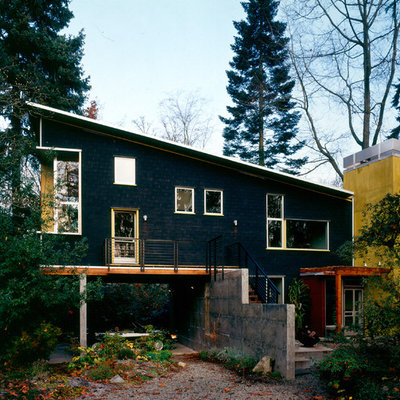 Contemporary black two-story exterior home idea in Seattle with a shed roof