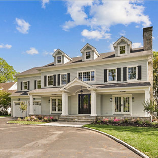 Traditional gray two-story exterior home idea in New York with a shingle roof