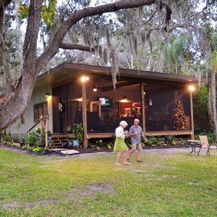 Small mountain style one-story concrete fiberboard exterior home photo in Tampa