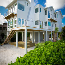 Beach Style Exterior by josh wynne construction