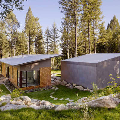 Inspiration for a small contemporary exterior home remodel in Salt Lake City with a shed roof