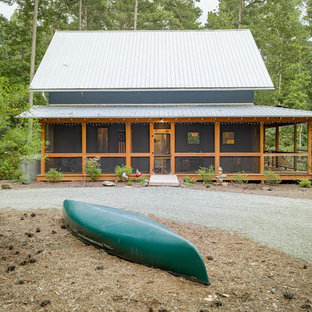 Small farmhouse blue two-story concrete gable roof photo in Raleigh