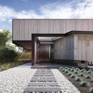 Idee per la facciata di una casa grande grigia moderna a due piani con rivestimento in legno