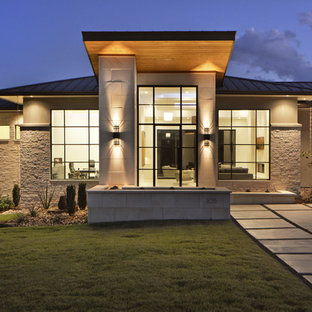 Contemporary one-story mixed siding exterior home idea in Austin