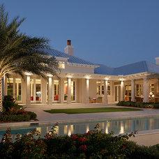Tropical Exterior by John David Edison Interior Design Inc.