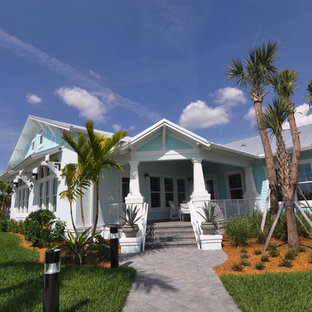 Large tropical blue two-story mixed siding gable roof idea in Tampa