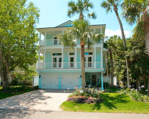 Inspiration For A Tropical Blue Three Story Wood Exterior Home Remodel In Jacksonville