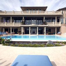 Mediterranean Exterior by Glenat Duxbury Interior Design