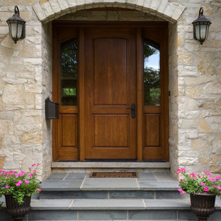 Fond Du Lac Stone Surrounds White Oak Front Door with Sidelights