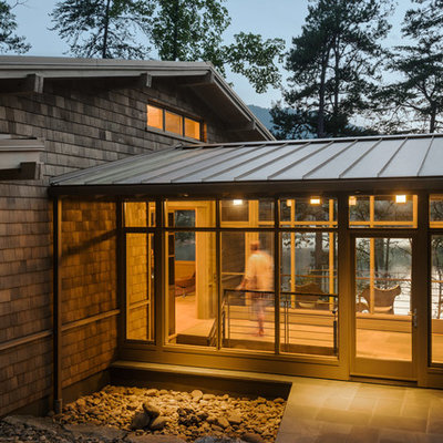 Inspiration for a mid-sized modern brown two-story wood exterior home remodel in Atlanta with a metal roof
