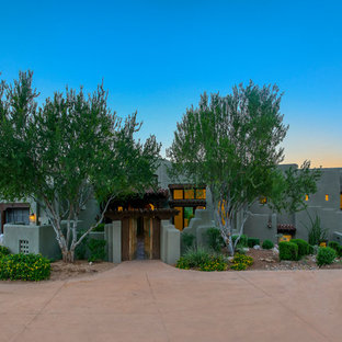 Mid-sized southwestern gray one-story exterior home idea in Phoenix
