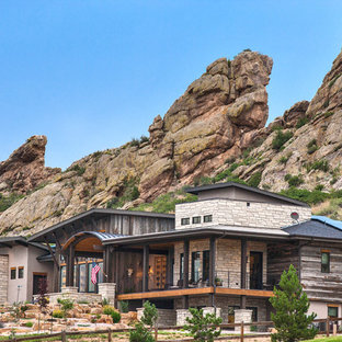 Inspiration for a rustic multicolored mixed siding house exterior remodel in Denver