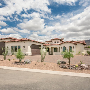 Mid-sized southwest white one-story stucco exterior home photo in Phoenix with a hip roof