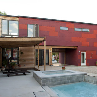 Design ideas for a contemporary two-storey apartment exterior in St Louis with mixed siding.