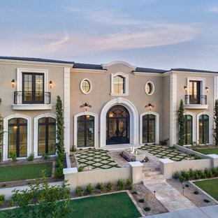 Huge tuscan beige two-story stucco house exterior photo in Phoenix with a hip roof and a shingle roof