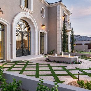 Ejemplo de fachada de casa multicolor, mediterránea, extra grande, de dos plantas, con revestimientos combinados, tejado a dos aguas y tejado de varios materiales
