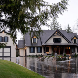 Transitional beige two-story exterior home photo in Vancouver