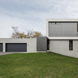 Minimalist gray two-story mixed siding exterior home photo in Milwaukee