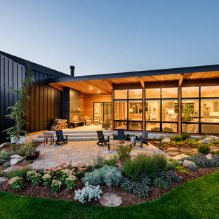 This is an example of a black contemporary house exterior in Seattle.