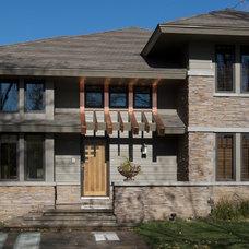 Traditional Exterior by Curt Hofer & Associates