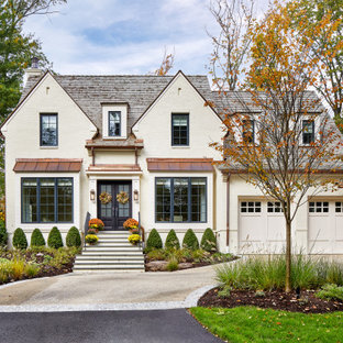 Inspiration for a large french country white two-story brick exterior home remodel in DC Metro with a shingle roof