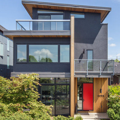 Inspiration for a mid-sized contemporary gray three-story mixed siding house exterior remodel in Vancouver with a shed roof