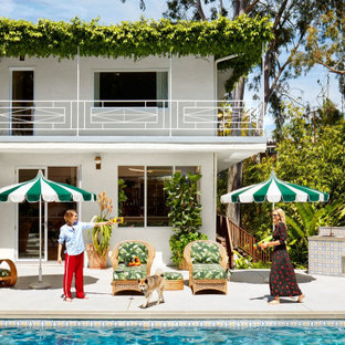 Tropical white two-story house exterior idea in Los Angeles