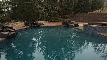 Free-form, custom, beach entry pool, in Merlin OR.