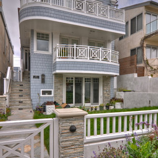 Inspiration for a mid-sized beach style blue three-story wood exterior home remodel in Los Angeles