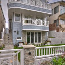Beach Style Exterior by LuAnn Development, Inc.
