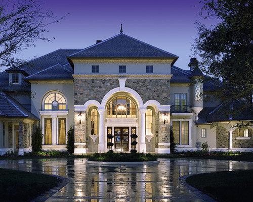 large elegant gray three story mixed siding exterior home photo in orlando