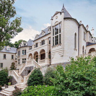Huge mediterranean beige three-story stone exterior home idea in Other