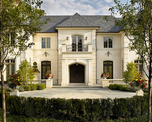large elegant beige two story stone exterior home photo in chicago