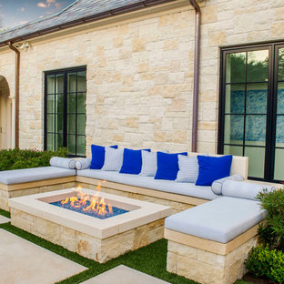 Example of a tuscan exterior home design in Dallas