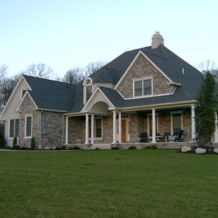 Inspiration for a large craftsman beige two-story mixed siding exterior home remodel in Philadelphia with a gambrel roof
