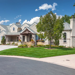 French country beige one-story stucco gable roof idea in Denver