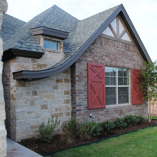 Example of an eclectic brown one-story exterior home design in Austin