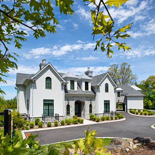 Large french country gray two-story mixed siding exterior home photo in New York with a mixed material roof