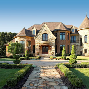 Example of a french country stone exterior home design in Detroit