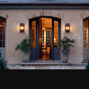Inspiration for a mediterranean brown two-story stucco exterior home remodel in DC Metro