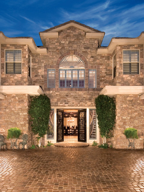 Inspiration For A Mediterranean Stone Exterior Home Remodel In Los Angeles