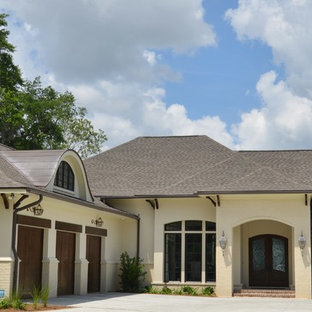 Inspiration for a contemporary beige one-story brick exterior home remodel in Birmingham with a shed roof