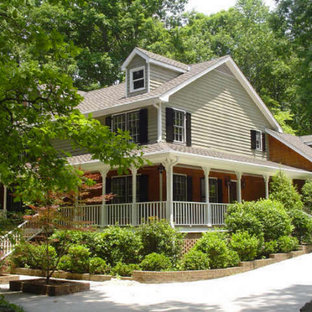 Large shabby-chic style green two-story gable roof idea in Nashville