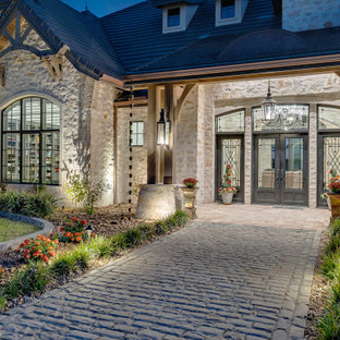Example of a french country exterior home design in Austin