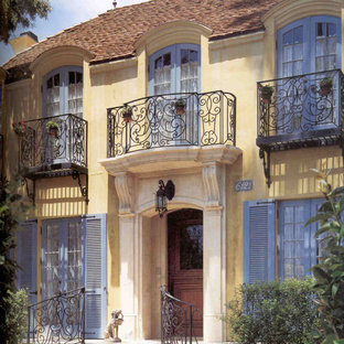 Inspiration for a french country two-story stucco exterior home remodel in San Diego