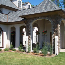 Eclectic Exterior by Mangum Design-Build, Inc.