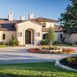 Example of a huge french country stone exterior home design in Austin